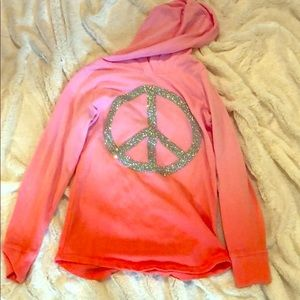 A hoodie with an peace sign on it